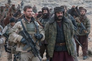 Chris Hemsworth and Navid Negahban in 12 Strong
